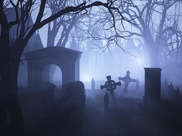 3D render depicting an overgrown neglected cemetaryin misty twilight.