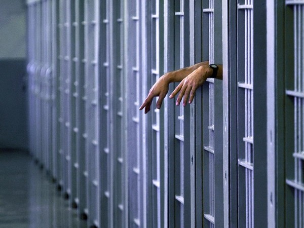 Hands of death row inmate in cell of Pontiac Correctional Institution, Pontiac, Illinois, USA.